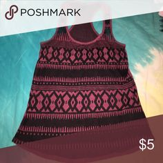 Tribal Tank Fits like a regular tank, Front material has tribal print and is semi see through, would recommend a bandeau/bralette underneath. Back of tank is plain burgundy Full Tilt Tops Tank Tops