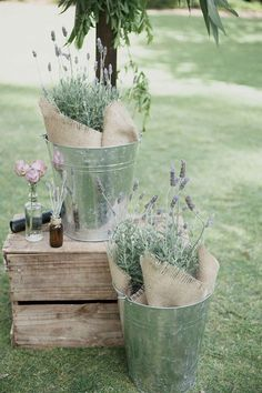 Silver buckets of lavender and burlap for rustic wedding ceremony via LoveHer Photography