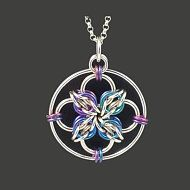 This attractive pendant is handwoven from sterling silver jumprings. It uses a chainmaille weave called Byzantine. Byzantine units are interspersed with larger silver rings and formed into a circle, making for a mostly-rigid design that greatly resembles a snowflake. The pendant measures a bit over an inch in diameter, making is nice and noticeable, but the weight is small enough that the pendant is comfortable to wear. A lacy silver design goes with anything and everything. This pendant is…