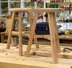 Three leg stool with tricky stretchers. They look simple, but are a challenge to pull off. By Robert Lang.