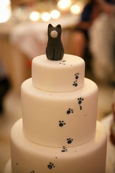 Three tier fondant cake with cute paw prints and kitty cat topper ~ we ❤️ this! moncheribridals.com - Tap the link now to see all of our cool cat collections!