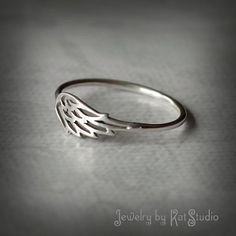 Hey, I found this really awesome Etsy listing at https://www.etsy.com/listing/175817159/angel-wing-ring-silver-wing-wing-ring