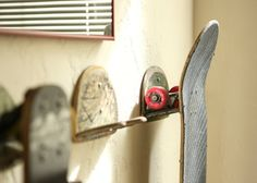 Skateboard hooks made out of skateboards. Upcycled Skateboard Board Hooks by jrydevisuals on Etsy, $18.00