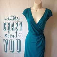 CK TEAL FAUX WRAP DRESS NWOT HP Beautifully draped, silky, stretchy and oh, so flattering! Wear anywhere, dress up or down. Amazing detail at the hip. Never worn, I LOVE this dress, it was just too big. From 60 Calvin Klein Dresses
