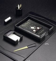 The Six Piece Black Leather Desk Set is a great gift for a business person and easily organizes a desk with the traditional look of genuine leather.