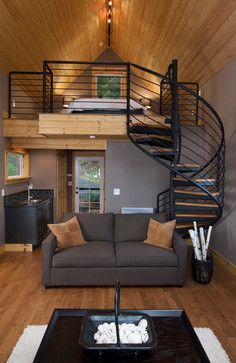 Olympia Eld Inlet Cabin Remodel and Studio Addition. Not an A-Frame, strictly speaking, but a lovely loft with lovely ironwork.