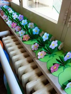 cut lily pads, then with square paper concertina fold and glue flowers onto it