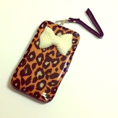 leopard print phone case and wallet So cute but never used.  Fits my iPhone 5c just fine - should fit any iPhone at least Bags Wallets