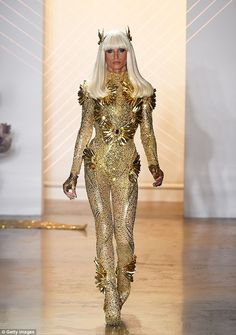 Phillipe Blond, one half of The Blonds design team, opened the brand's show Thursday night during New York Fashion Week wearing a crystal-encrusted body suit featuring fold feathers