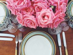 Pink roses bouquet, vintage cutlery. Romantic tabletop. Vintage, Bavaria porcelain plates and cristal glasses. Outdoor dinner.