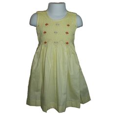 """Freya (Lemon) - Traditional smocked dress with embroidery overlay.  Sleeveless style.  Button fastening of the straps and back, with matching fabric """"ribbons"""" to tie a bow. Available in sizes 1-8 years."""