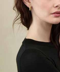 Bar earrings with a geometric faceted surface. An effortless, super cool touch to your contemporary ensemble. 18K gold plated sterling silver. 2m long.