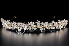 This gold wedding headband is decorated with frosted 14k gold plated leaves, ivory freshwater pearls, swarovski crystal beads and rhinestone flowers. The length of the decoration is 8.5 inches and it