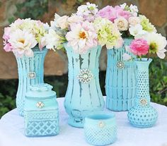 Glass Bottle and Tin Can Repurpose  Those old ugly glass flower vases.......?