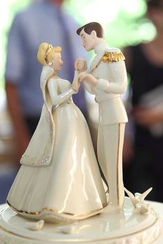 I legit have a Cinderella wedding cake topper.  It isn't exactly like this, but I bought it the last time we were in Disney World.  It isn't exactly a cake topper either, but that's what I'm using it for.  So Excited!