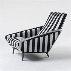 The upholstery of this couch chair is very unique and groovy pattern. The pattern creates emphasis on this chair.