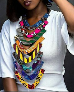 Make a grand entrance with this 8 step tiered Ankara statement piece. Each neckpiece is made out of various ankara prints and each is unique. African Attire, African Wear, African Fashion Dresses, African Dress, Ankara Fashion, African Style, African Women, Diy African Jewelry, African Accessories