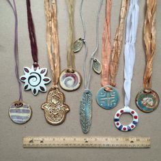 Ceramic Necklaces and Pendants. High fire stoneware & porcelain with different glazes. Handmade in St. Louis by Linda Wiggen Kraft. Some available at ETSY shop – CreativityForTheSoul (no spaces). Contact thru email for others. https://www.etsy.com/shop/CreativityForTheSoul