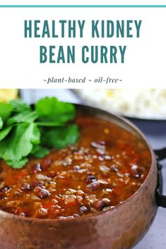 Spicy, plant-based and oil free kidney bean curry is layered with the flavors of fragrant Indian-inspired spices in a sweet tomato sauce with fresh squeezed lemon that brings it all together. This is wonderful served over rice or your favorite grain. #curry #vegancurry #Indianchili #plantbasedoilfree #cookinggarlic #anothermusicinadifferentkitchen #vegandinnerrecipes #plantbasedmaindish #healthycurry #lowcaloriedinner #forksoverknives #wholefoodplantbased
