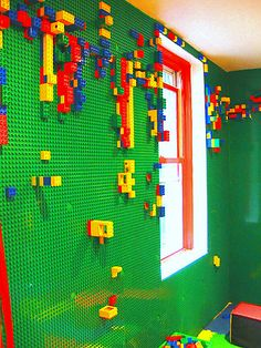 Lego wall--one answer to the challenge of how to store the Legos, sort the pieces, keep them off the floor, away from the dog...