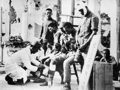Wounded Chinese soldiers receiving aid from a Japanese medic, 1938