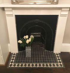 Original victorian fireplace with black and white tiles, hearth. Decor tiles