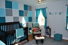 A gorgeous #turquoise and #gray #colorblock wall in this gender neutral #nursery.
