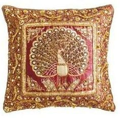 Pillows showing a peacock spreding her golden wings.