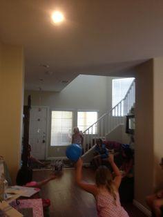 Empty soda bottles + big bouncy ball= indoor bowling. Slumber party games.