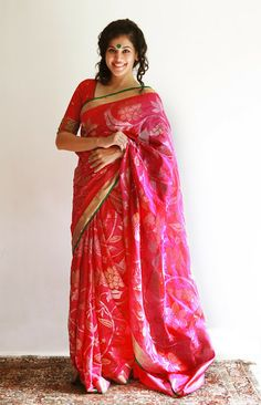 An allover floral jamdani kota saree styled with a raw silk blouse highlighted with zardozi border sleeves