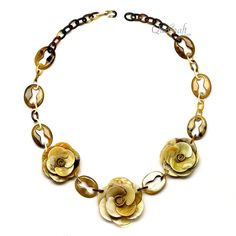 A beautiful chain necklace handmade from buffalo horn. High polish finish. Lightweight. Actual colors may vary. 28.74 (73cm) length. Link: 1.22 (3.1cm) length x 0.98 (2.5cm) width. Flower: 2.36 (6cm) diameter.