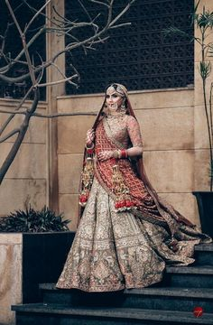 Looking for A Sikh bride in a metallic color lehenga wearing kaleere and antique jewellery? Browse of latest bridal photos, lehenga & jewelry designs, decor ideas, etc. on WedMeGood Gallery. Indian Bridal Outfits, Indian Bridal Lehenga, Indian Bridal Fashion, Indian Bridal Wear, Pakistani Bridal, Indian Designer Outfits, Indian Dresses, Sabyasachi Lehenga Bridal, Anarkali