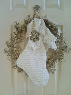 Love the sparkle of the wreath, and the simple chennile stocking...with the touch of bling.