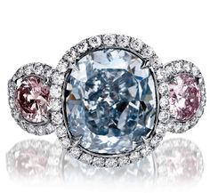 Natural Fancy Intense Blue Cushion Cut Diamond set in Handmade Platinum micropave diamond ring with 2 Round Pink diamonds on the sides