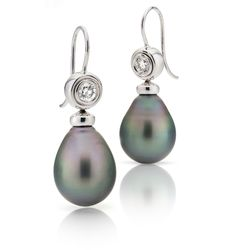 Daniel Moesker peacock earrings with cook island black pearls also known as tahitian pearls  set under a pair of 0,54ct tw vvs diamonds in 18kt white gold.
