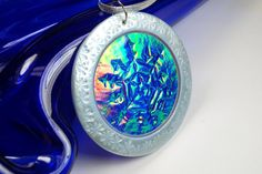 Round Snowflake Christmas Ornament with ice blue accents  Polymer Clay with Holo Effect