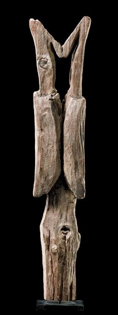 """Africa   Fragment of a grave post """"aloala"""" from the Mahafaly people of Madagascar   Light brown wood, with a matt patina"""
