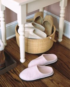 Basket of slippers by front door to help with no shoes in the house rule