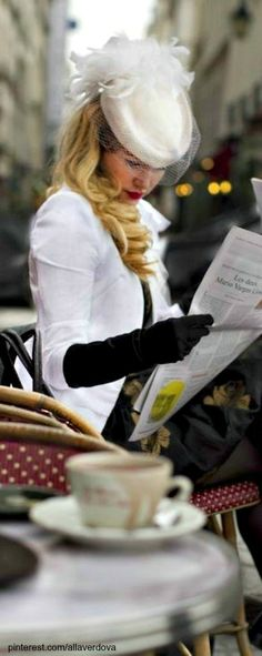A perfect day in Paris. Reading the paper and sipping a caƒe latte while looking glamorous.