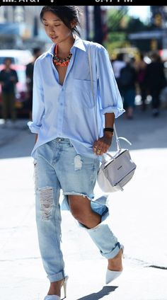 Shot during NYC Fashion Week by Tommy Ton. Exaggerated shirt, pants, and tears. Exaggerated everything.
