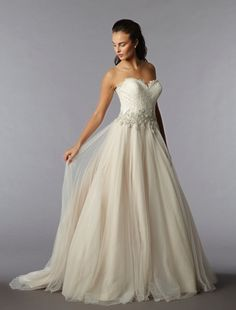 Danielle Caprese - Sweetheart Ball Gown in Tulle. This ball gown features a sweetheart neckline with a natural waist in tulle and lace. It has a sweep train.