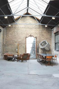 There is nothing I don't love. Tall ceilings? Check. Exposed brick? Sounds good. Giant mirror? Great! Random time-machine part on the wall? You shouldn't have! But I'm glad you did.