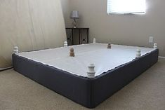 Upholstered Box Spring with legs.--- It is a really cool Idea but it did not work on my bed---I tried it a long time | http://your-home-design-photos-collection.blogspot.com
