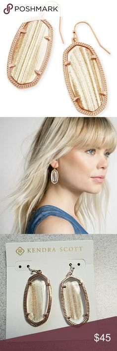 """NWT Kendra Scott Elle Earrings Custom oval gold dusted glass stones in a thin metallic frame are a perfect match for any ensemble.  • 14K Rose Gold Plated Over Brass • Size: 1.75""""L x .75""""W on earwire • Material: gold dusted glass  NWT - never worn or taken off of packaging  *Please note: Due to the one-of-a-kind nature of the medium, exact color patterns may vary slightly from the first image shown.* Kendra Scott Jewelry Earrings"""