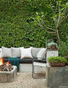 The terrace is a true outdoor room with a built-in banquette and a wall-like ficus hedge. Upholstery and cushion covers, Perennials.Bright Light and Balmy Air