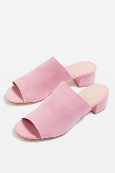 The mule trend lives on – we love this simple yet classic pink pair with cute peep toe detail and a low heel.