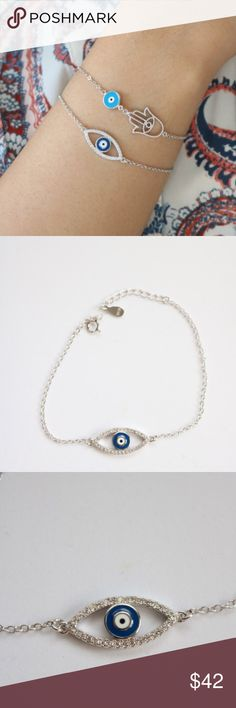 "Sterling Silver Evil Eye Bracelets Sterling Silver Evil Eye Bracelets.  Blue Evil Eye Bracelet: 6.5"" + 1.5""  Silver Hamsa with evil eye Bracelet: 6.5"" + 1.5""   Marked: 925     Set of 2! Jewelry Bracelets"
