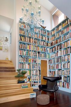 not crazy abt the chandelier, but love those aqua bookshelves.  and check out the little cut-out nook in the first step!