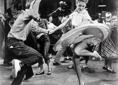 Rockabilly couple dancing, we wish it were today. Love the dress and his style.