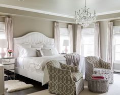 Master Bedroom. Gray Master Bedroom. Gray Paint Master Bedroom. Pink and gray bedroom features gray walls lined with a white tufted camelback bed. #MasterBedroom